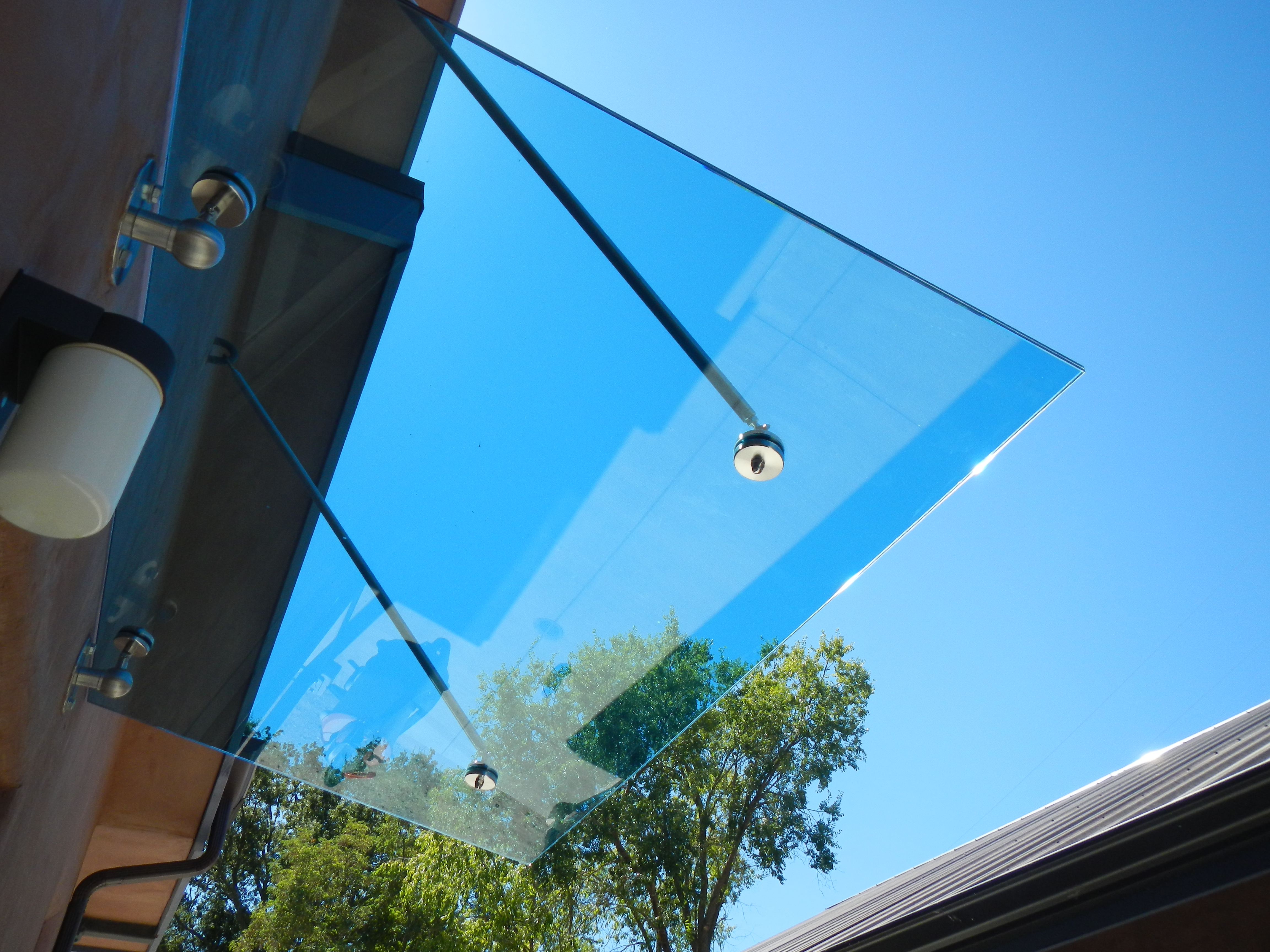 Glass awnings jerry james banjo news for Glass awnings for home